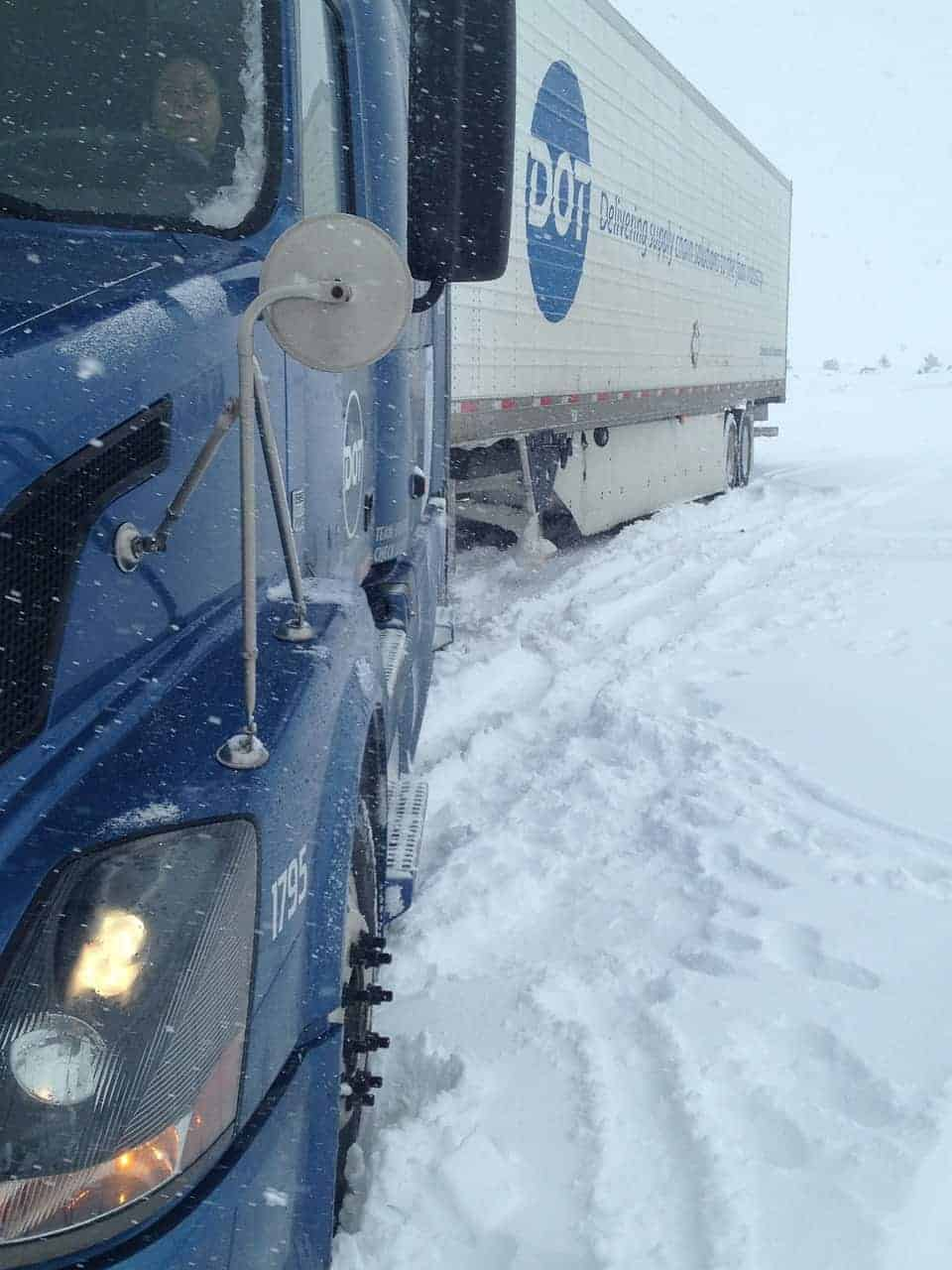 Delivery truck stuck in snow
